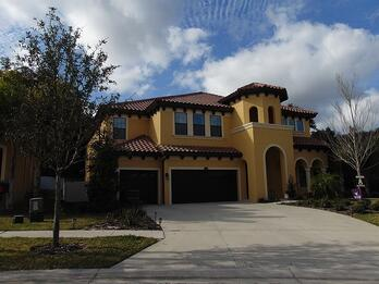 Yellow house to show exterior paint Tampa